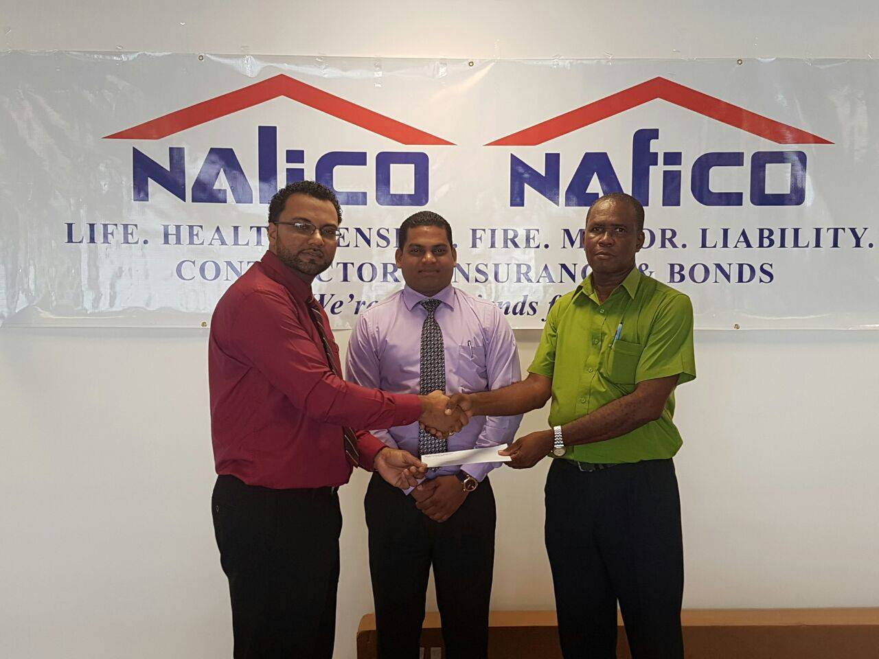 NALICO/NAFICO settles Group Personal Accident claim for death of Sentinnel Security Officer who was killed by bandits whilst on the job. In photo are Mr. Cedric Browne, Operations Manager of Sentinnel Security receiving cheque for $1,000,000 from NAFICO's representatives, Mr. Anil Singh - Fire Manager and Mr. Shaun Salim - Assistant Fire Manager.