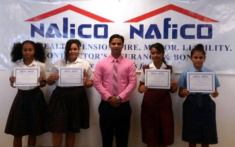 Representative of NALICO/NAFICO Vickash Persaud (center) alongside Students from various secondary schools across Guyana whom were presented with certificates of participation after completing their work studies.