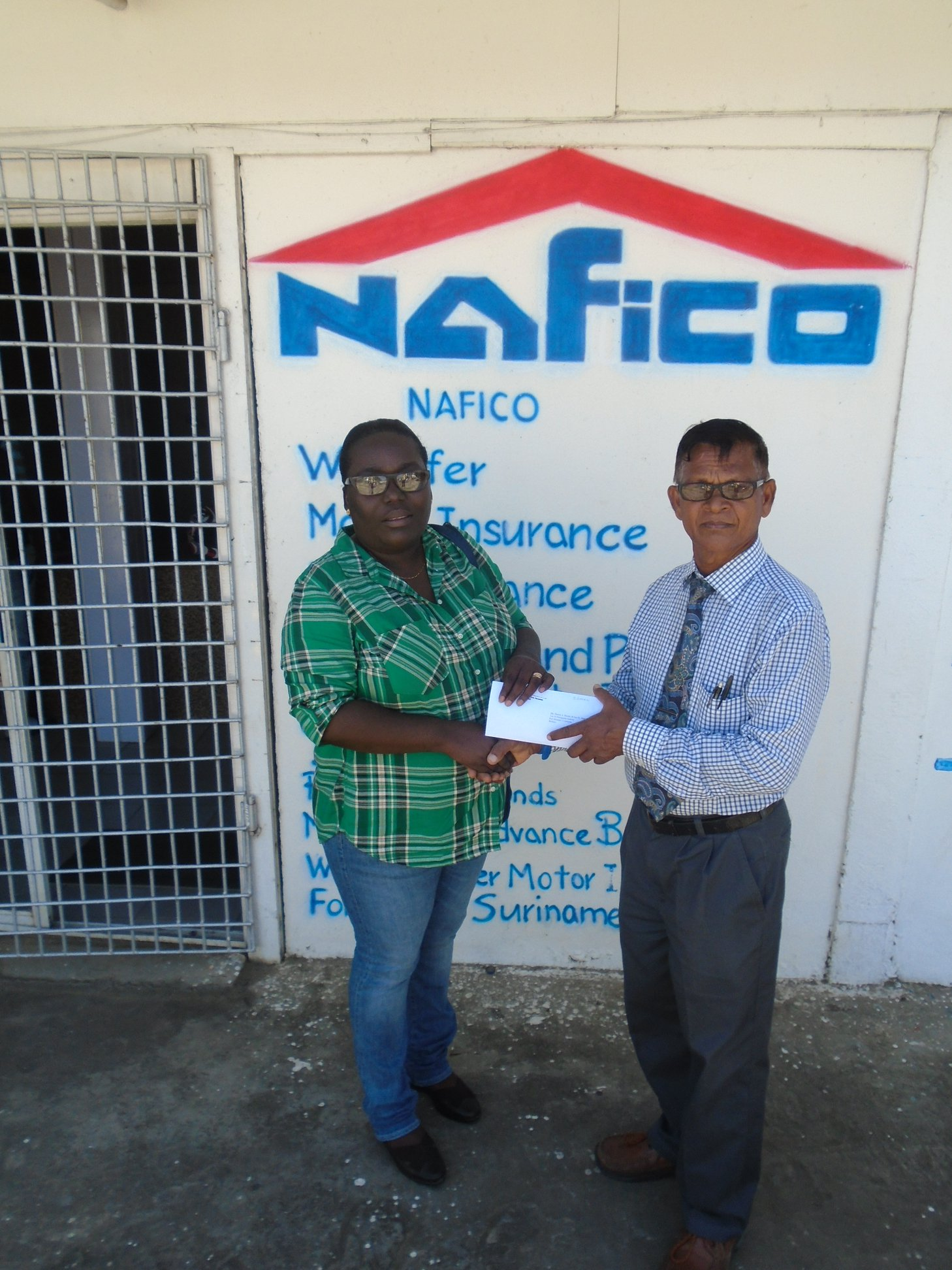 NALICO/NAFICO settles multi-million dollar claim as a result of windstorm which caused damage to building in Port Mourant, Corentyne Berbice.  In picture, Jerome Soman, Nafico's Manager, hands over a cheque to the affected policy holder to cover the value of the damages.  At NAFICO, we ensure you are properly covered against these unexpected events.